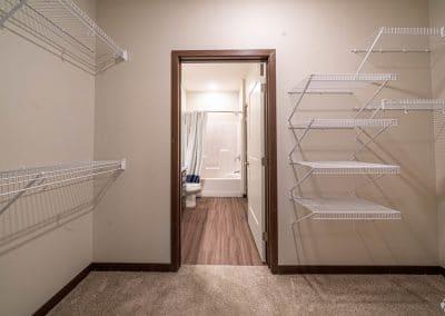 lake-jonathan-flats-chaska-mn-main-bedroom-walk-through-closet-to-bath